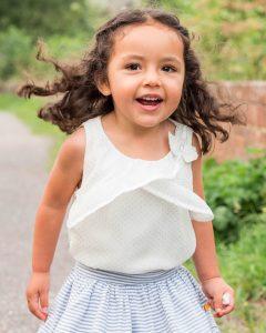Little girl runs and smiles