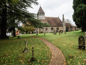 English country church and the path through its churchyard
