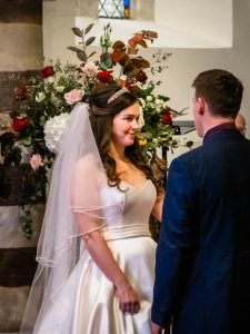 Bride and groom in an English country church