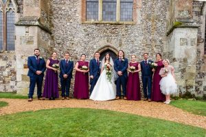 Bride, groom, bridesmaids and ushers outside an English country church