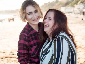 Laughing lesbian couple on Bournemouth beach