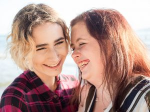Lesbian couple smiling together