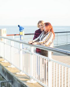 Lesbian couple talking on Bournemouth Pier