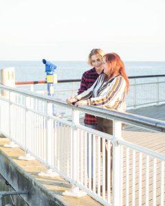 Lesbian couple talking on Bournemouth Pier