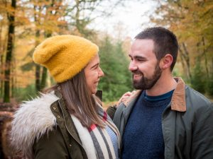 Smiling couple in autumnal woodland