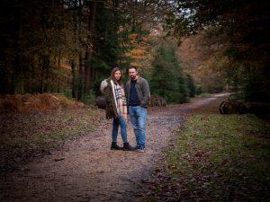Couple on woodland path in autumn
