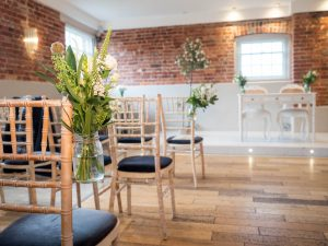 Chair decorations in the ceremony room at Sopley Mill