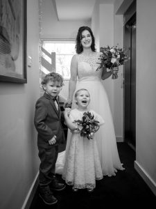 Bride with young bridesmaid and page boy waiting to enter the ceremony room at Sopley Mill