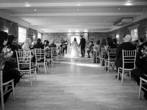 Bride and groom in the ceremony room at Sopley Mill