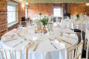 The dining room at Sopley Mill laid for a wedding breakfast