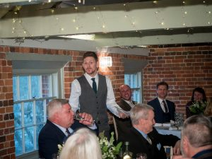 Best man making his speech during wedding breakfast at Sopley Mill