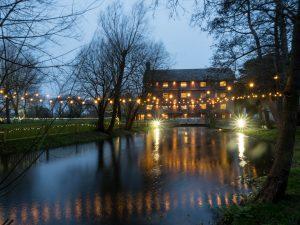 Sopley Mill at dusk, illuminated by floodlights