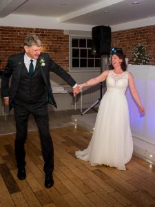 Bride and groom enjoying their first dance at Sopley Mill
