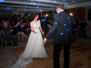 Bride and groom dancing in front of their guests during their wedding reception at Sopley Mill
