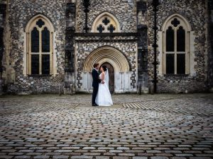 Bride and groom in closed pose in front of the door at Winchester's Great Hall