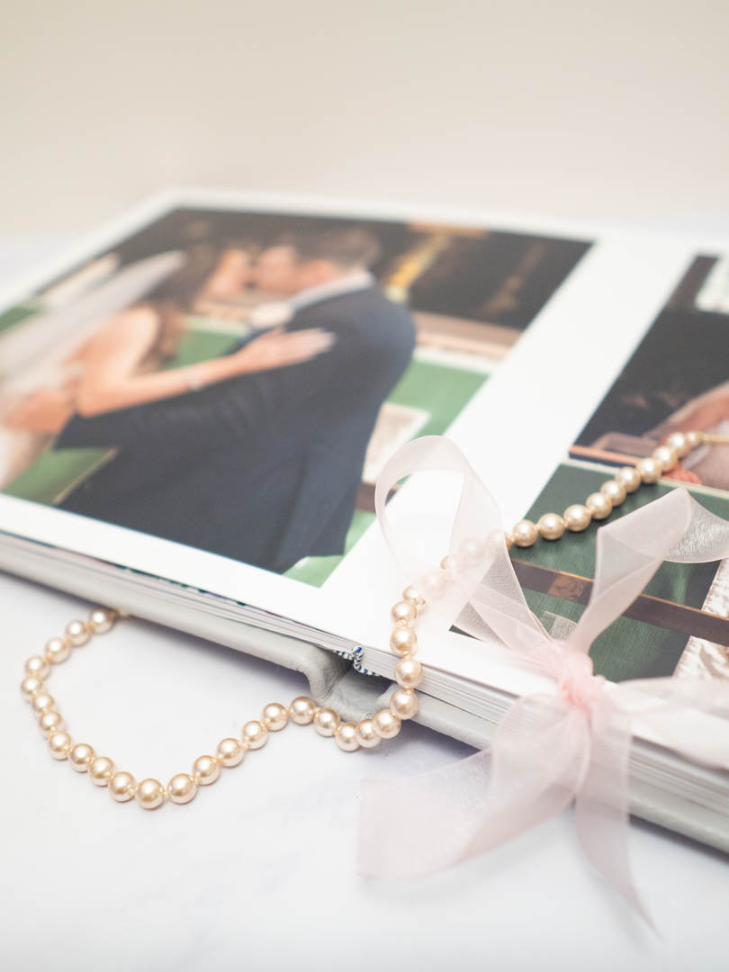 Pearls draped across a luxury wedding album from Dom Brenton Photography