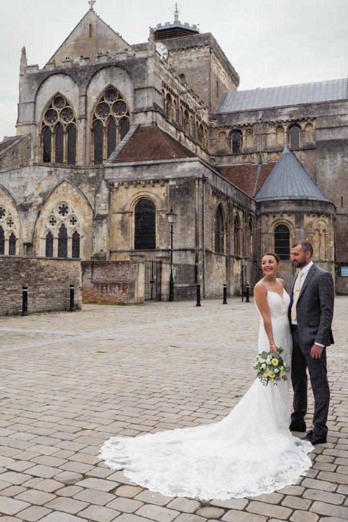 'Newlywed' couple outside Romsey Abbey, Hampshire – Dom Brenton Photography