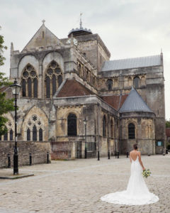 Bridal portrait outside Romsey Abbey, Hampshire – Dom Brenton Photography