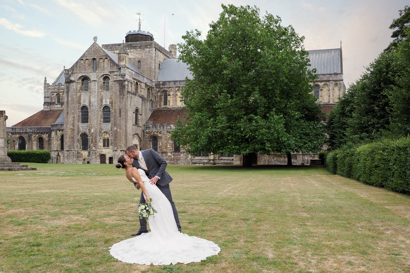 Romantic portrait of 'newlywed' couple outside Romsey Abbey, Hampshire – Dom Brenton Photography