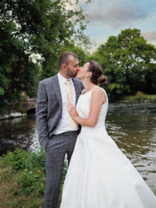 'Newlywed' couple kiss beside the River Test, Romsey – Dom Brenton Photography