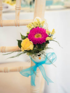Posy decoration on a dining chair by Just Add Flowers