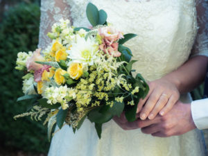 Bridal bouquet of roses, dahlia, limonium and cream stocks