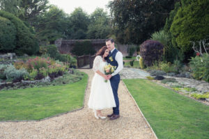 Bride and groom hold each other in the grounds of The Orangery Suite
