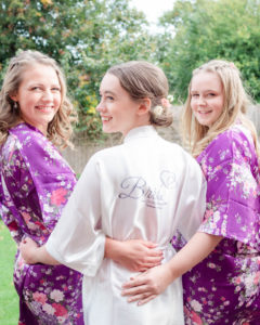 Michaela and her bridesmaids in their commemorative wedding dressing robes