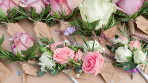 Wedding buttonholes – white, pink and purple roses – created by Willow Florist