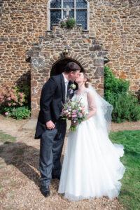 Michaela and Rupert kiss outside church