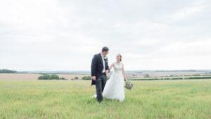 Michaela and Rupert walking across a field