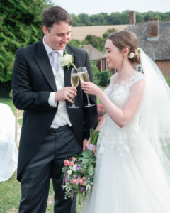 Rupert and Michaela toast their new life together