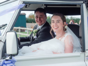 MIchaela and Rupert prepare to drive away from their wedding reception