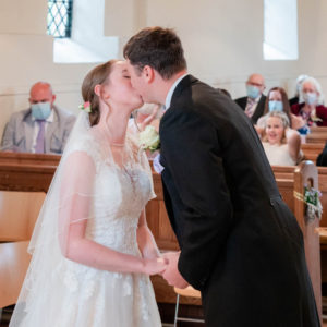 Rupert and Michaela kiss after the Vicar pronounces them husband and wife