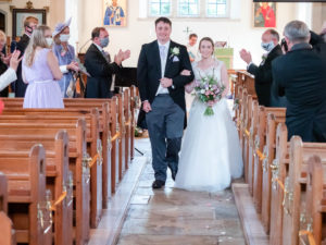 Michaela and Rupert walk down the aisle in Alderholt church after getting married