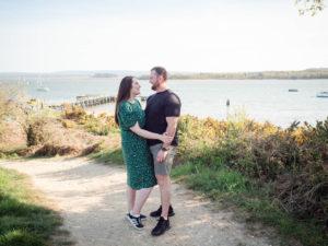 Couple on engagement photo session, enjoying romantic moment above Lake Beach, Poole Harbour, Dorset