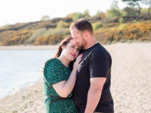 Couple on engagement photo session, enjoying romantic moment on Lake Beach, Poole Harbour, Dorset