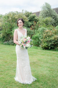 Bride holding bouquet on a lawn