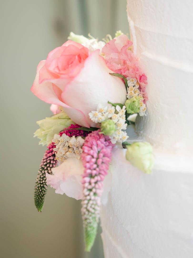 Close-up of rose decoration on wedding cake