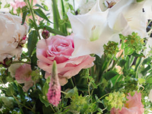 Close-up of floral decoration incorporating pink roses and white llilies