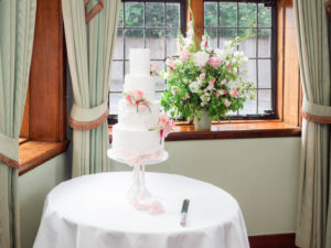 Wedding cake in front of the window in The Paris Room in The Montagu Arms, Beaulieu